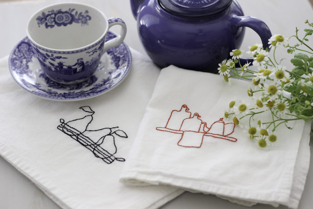 Embroidered tea towels with Aurifloss.