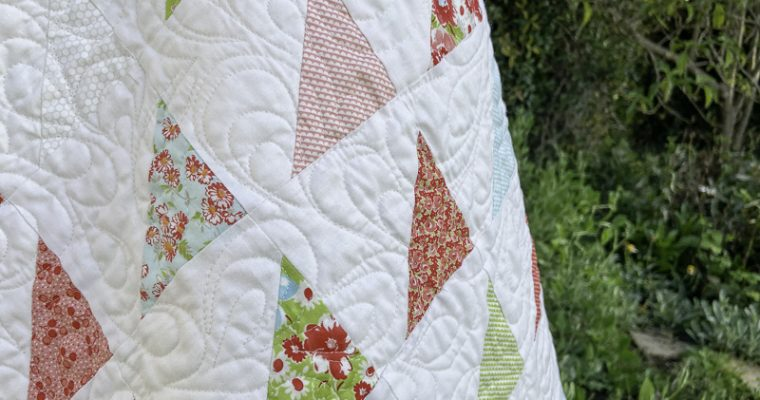 Patchwork Gifts Book Tour: A Scrappy Triangle Baby Quilt